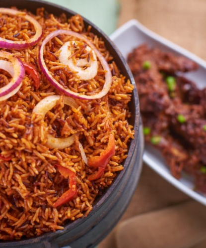 jollof rice in a pot with chicken