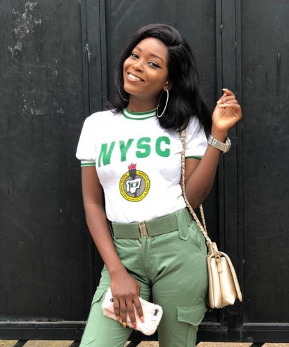 female youth corper in NYSC outfit