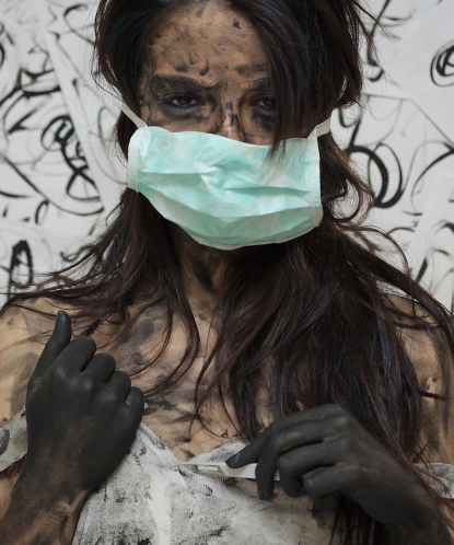 depressed woman with mask and painted hands